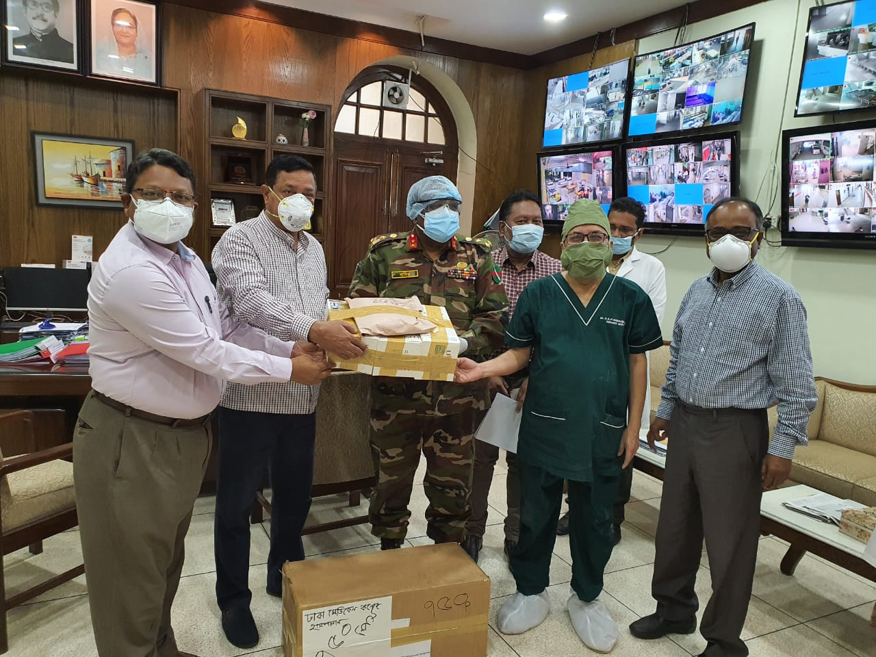 Donation of KN-95 Mask by BCPS to Director, Dhaka Medical College Hospital ( From the left Professor Md. Billal Alam, Councillor & EC Member, BCPS, Professor Khan Abul Kalam Azad, Councillor & EC Member, BCPS, Brig. Gen. Md. Nasir Uddin, Director, Dhaka Medical College Hospital, Professor Abul Bashar Mohammed Khurshid Alam, Honorary Secretary, BCPS, Professor Md. Mujibur Rahman, Councillor & Honorary Controller of Examinations, BCPS)