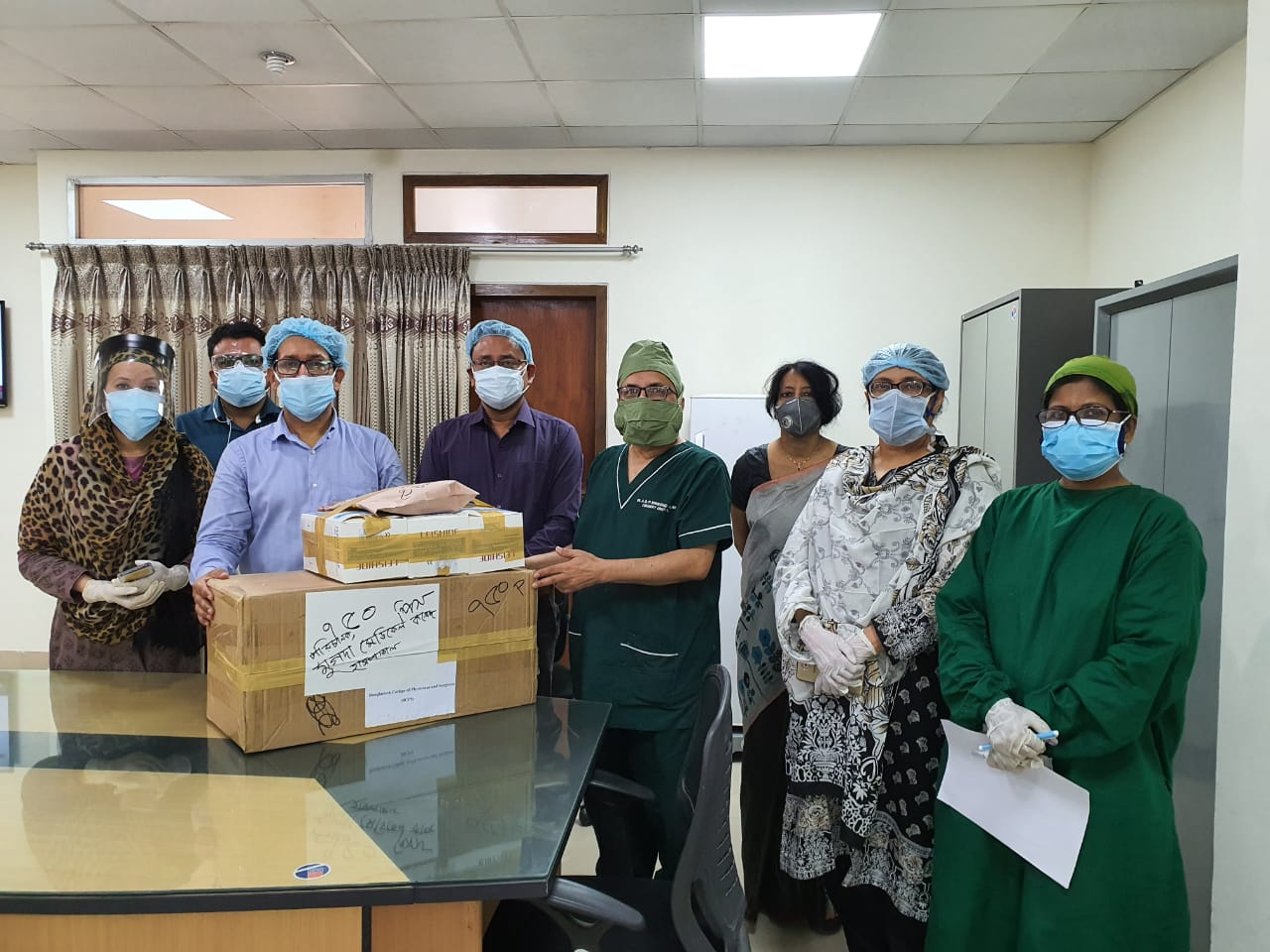 Donation of KN-95 Mask by BCPS to Director, Mugda Medical College Hospital  ( From the left Prof. Rubina Yasmin, Prof. & Head, Department of Medicine, Dr. Shah Golam Nabi, Principal &Director (Acting), Dr. Mahbubur Rahman Kachi, Assistant Professor, Dept. of Surgery, Mugda Medical College, Prof. Abul Bashar Mohammed Khurshid Alam, Honorary Secretary, BCPS, Dr. Fahmida Naz, Assistant Professor, Obst. & Gynae and Prof. Nahid Yeasmin, Head of the Dept, Obst. & Gynae, Mugda Medical College)